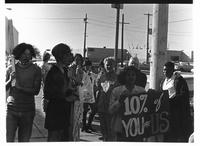 10% of you are us sign during Gay Liberation Front picket at SDPD, 1971